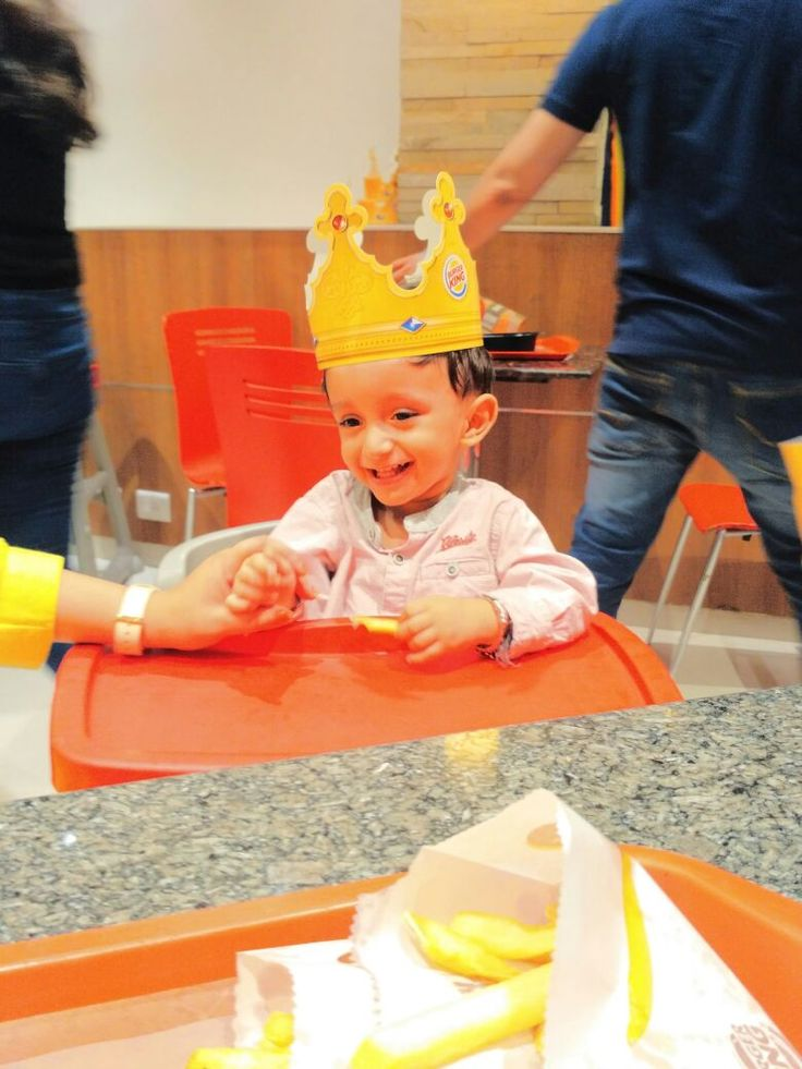 Baby is enjoy french fries at burger king