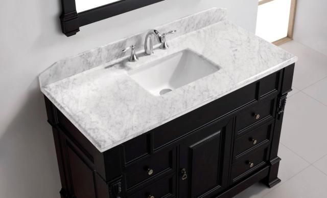 Want to do your own bathroom cabinet and countertop? Standard-size bathroom vanity tops allow you to do just that. See how.
