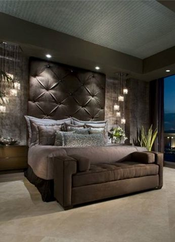 Love the lighting on the sides of the bed and the textured wall behind the bed.  Head board-ber