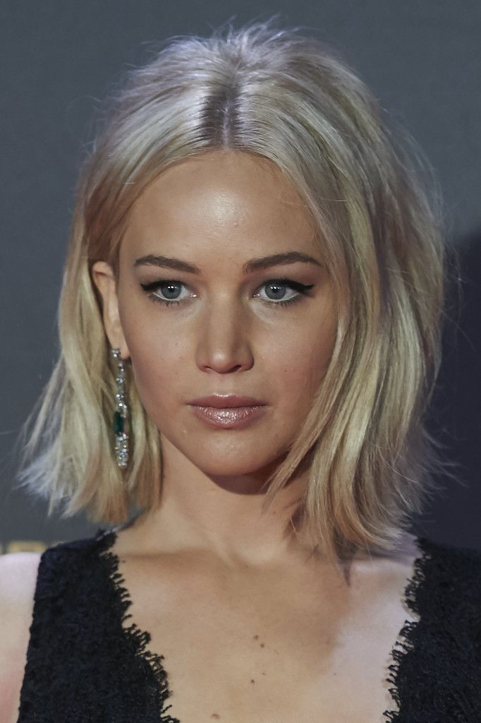 Jennifer Lawrence Flip - Jennifer Lawrence channeled the '60s with this teased, center-parted flip at the Madrid premiere of 'The Hunger Games: Mockingjay Part 2.'