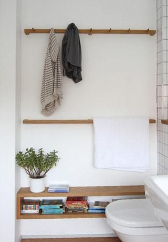 peg rail, towel rail... I like how this looks like a nice room, not just a toilet. I like the shelf.
