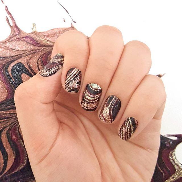 "Marble nail art made easy: ""Total Bombshell"" features glittering black, burgundy, gold, and rose gold swirls! #incoco #nailart #marblenails #marblenailart"