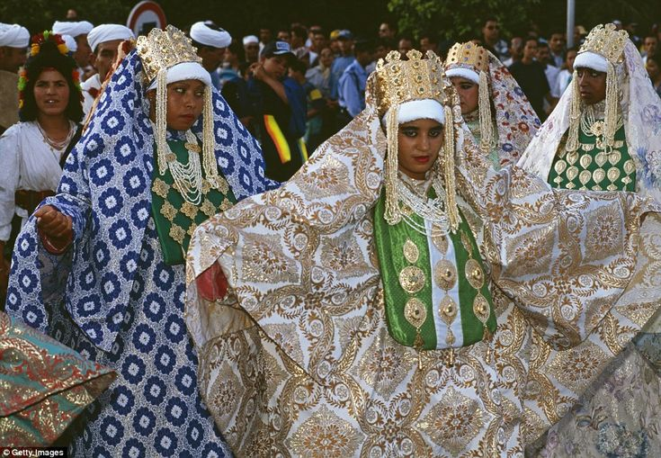 Big affair: Generally, a Moroccan bride will wear silk, chiffon or satin garments - she will be required to change several times during the ceremony