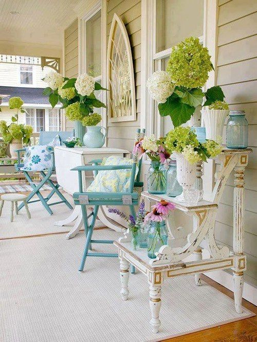 quaint, shabby chic porch....I'd be sipping my sweet southern tea