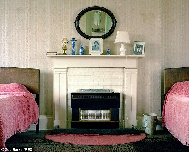 The sisters' guest room is decorated with pink candlewick bedspreads, an…