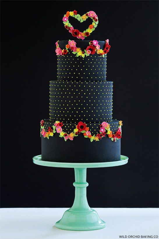 This pretty, black wedding cake is so cheery with its tiny, bright blooms and polka dots. Wild Orchid Baking, NH.