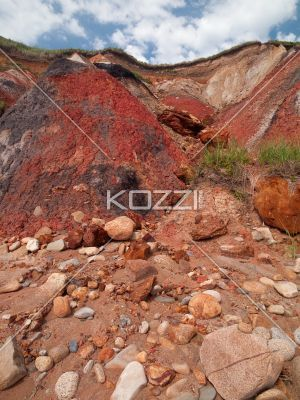 low angle view of sandstone hills. - Low angle view of sandstone hills with clouds and sky in background.