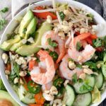 If you like spring rolls you're going to love this easy Shrimp Spring Roll Salad loaded with large shrimp, sliced cucumber, avocado, red peppers and fragrant herbs on a bed of crispy lettuce and tossed in a delicious paleo-friendly dressing.