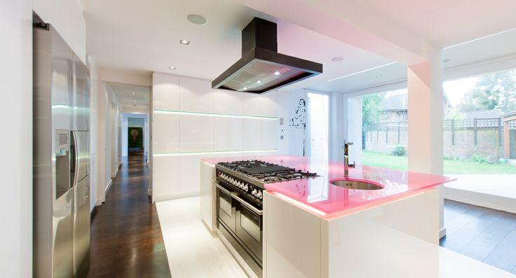 Fun, sleek kitchen, pink worktop/ residential 4M Group www.4mgroup.co.uk