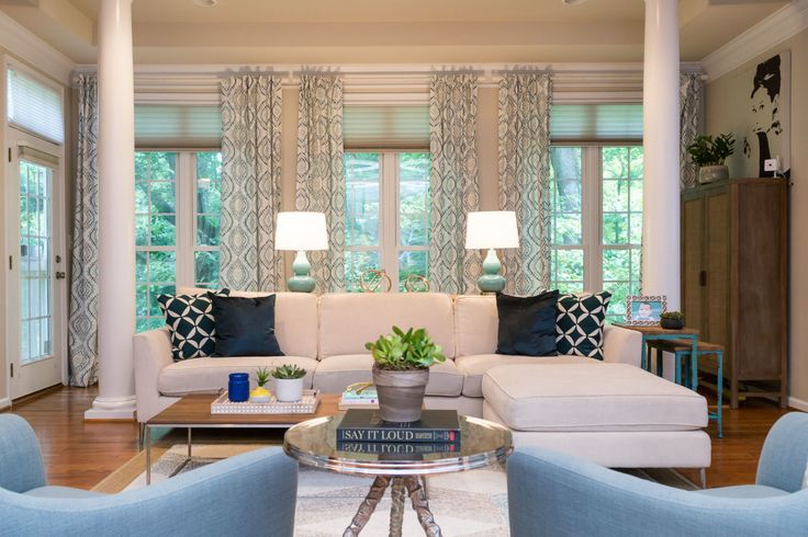 Relaxed and casual family room. Blue accents white sofa