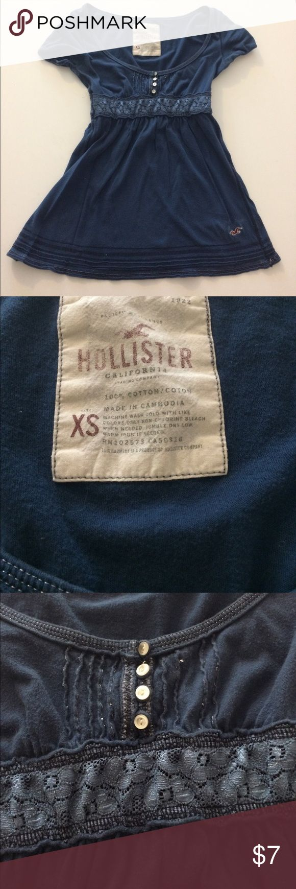 Navy blue Hollister top with lace Used Hollister top with lace. Tight  short sleeves. Cut lower in the front but looks great with a tank top under. Hollister Tops Blouses