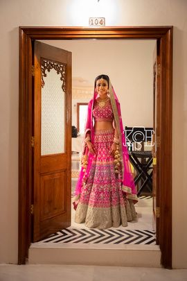 Bridal Lehengas - Pink Bridal Lehenga with Blue and Gold Embroidery, Gold Sequinned Broad Border | WedMeGood #wedmegood #indianbride #indianwedding #pink #bridal #sequinned #dupatta #lehenga #bridallehenga