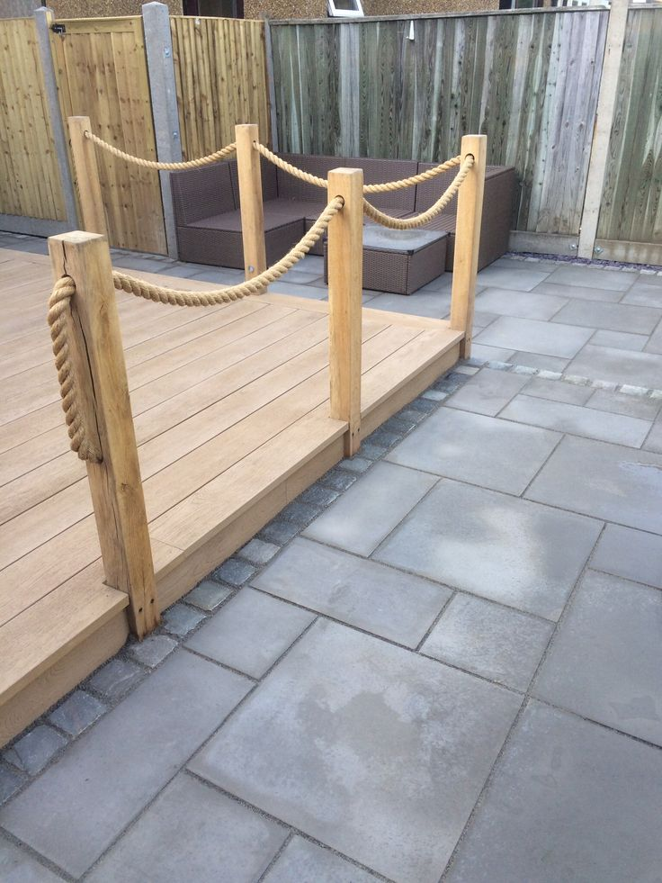 Millboard 'Smoked Oak' composite decking with new oak and rope balustrading. (Chessington Garden Centre)