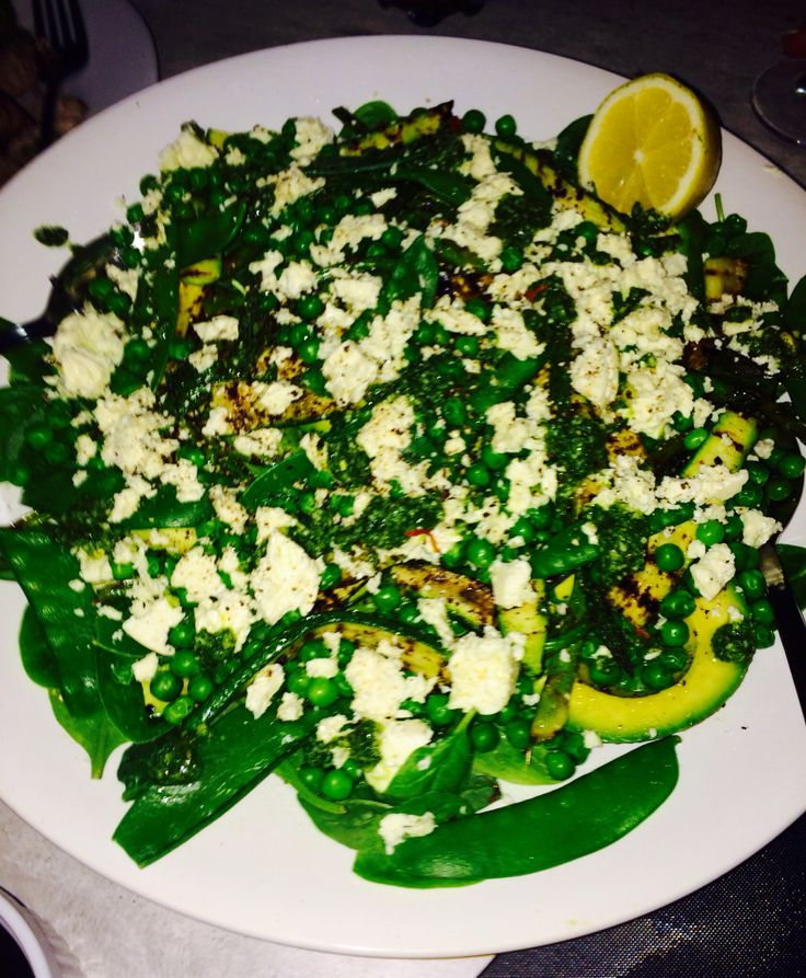 Green Salad - Baby Spinach, grilled courgettes & asparagus, pea shoots, baby peas and avo topped with goats cheese, basil pesto and balsamic glaze.