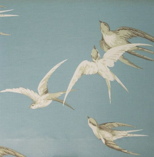 Swallows Linen Fabric Elegant design of swallows soaring through a bright blue sky, taken from a 1930s design