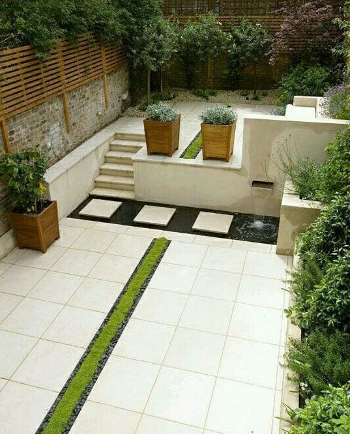 Classic garden with planted Rill, copper water feature, limestone paving and steps.