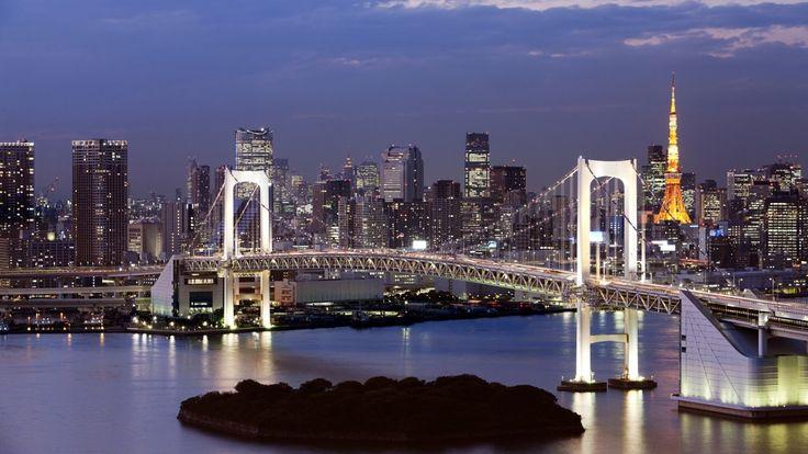 Rainbow Bridge and Tokyo Tower at dusk. Tokyo Prefecture, Japan