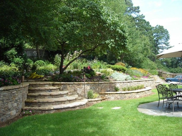 find this pin and more on country living garden wall slope stabilization ideas for garden design natural stone retaining walls - Landscape Design Retaining Wall Ideas