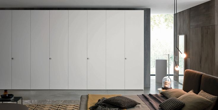 Alfa , Wardrobes, Products | Novamobili. The Alfa hinged door wardrobe allows you to tailor solutions to suit any space requirements and individual needs. Available in all matt and gloss lacquered colours, in textured, eco-wood and super-matt finishes. It can be paired with the new Stone handles in Carrara marble, Wood-Class handles in rovere miele and rovere terra and Metal handles in the bronze finish.  #wardrobe by #Novamobili. #interior #design #aboutWARDROBE