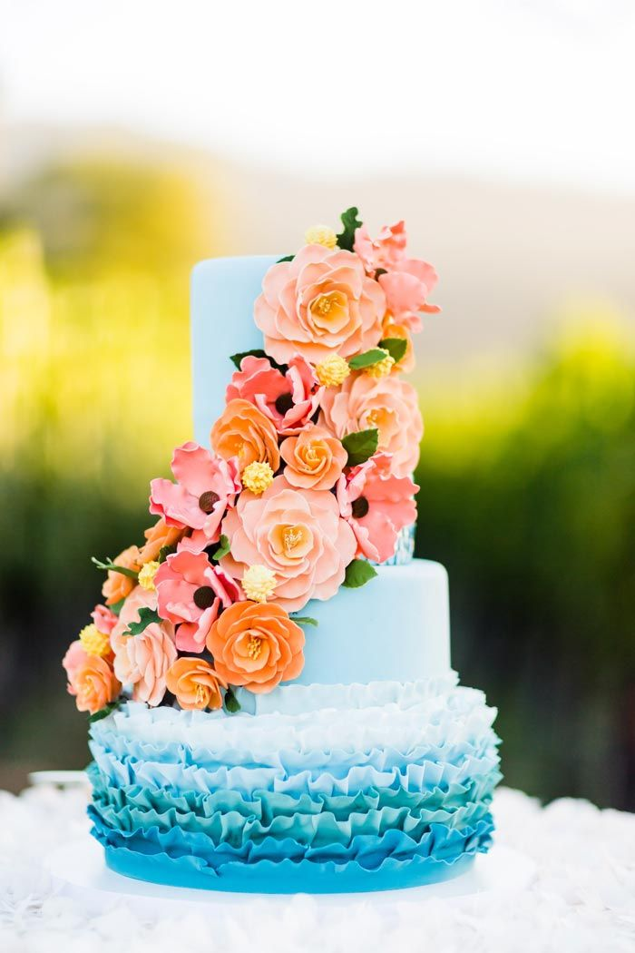 Ombre blue wedding cake with coral flowers // featured on the Modern Wedding Blog.