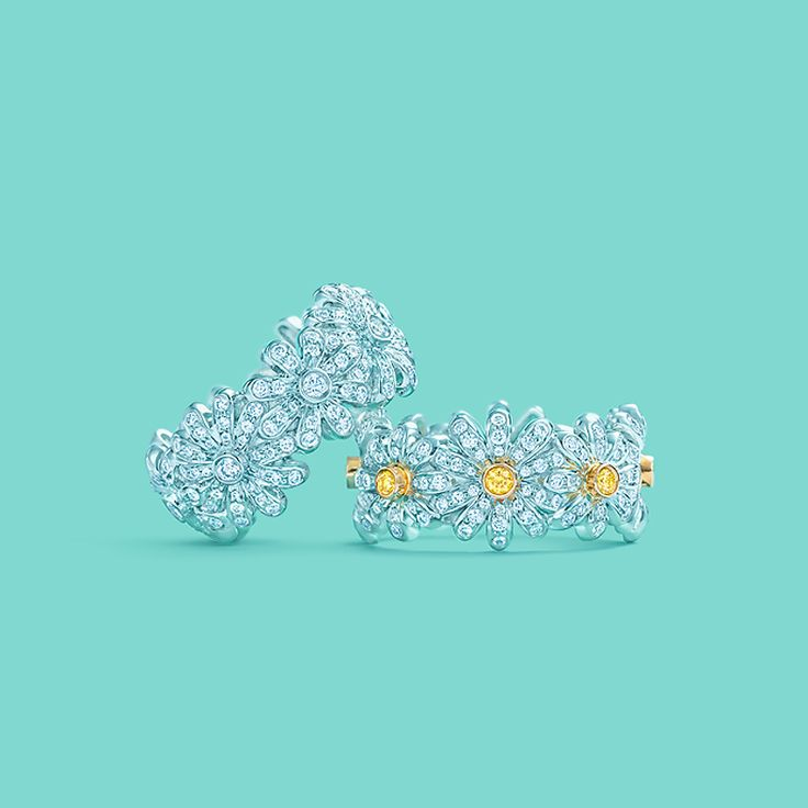 Tiffany & Co. Schlumberger® Daisy rings, from left: diamonds in platinum, and yellow and white diamonds in platinum and 18k gold. #TiffanyPinterest