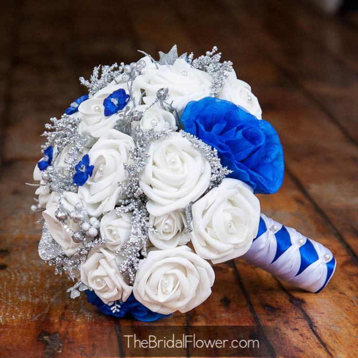 royal blue and silver wedding centerpieces%0A Royal blue and silver accented winter wedding bouquet   The Bridal