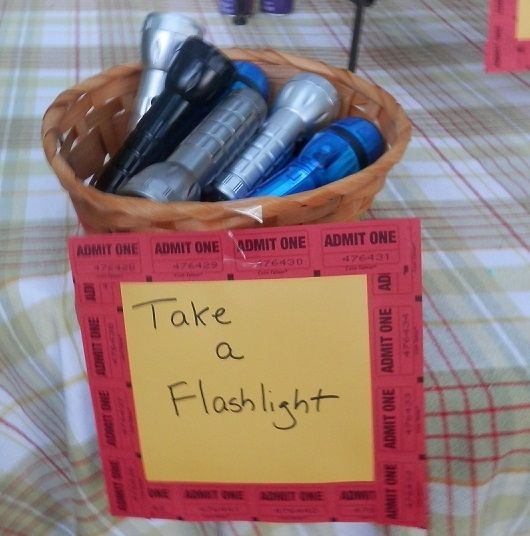 11 Steps to Throwing a Backyard Movie Party: Give out Flashlights