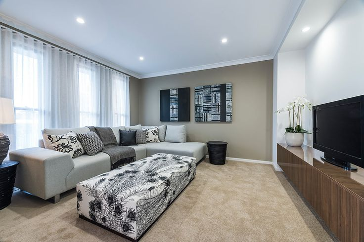 #Living-room #interior #design #inspiration from #Ausbuild's Newbury display home. This room is full of signature, statement pieces including the #peacock #inspired #ottoman.