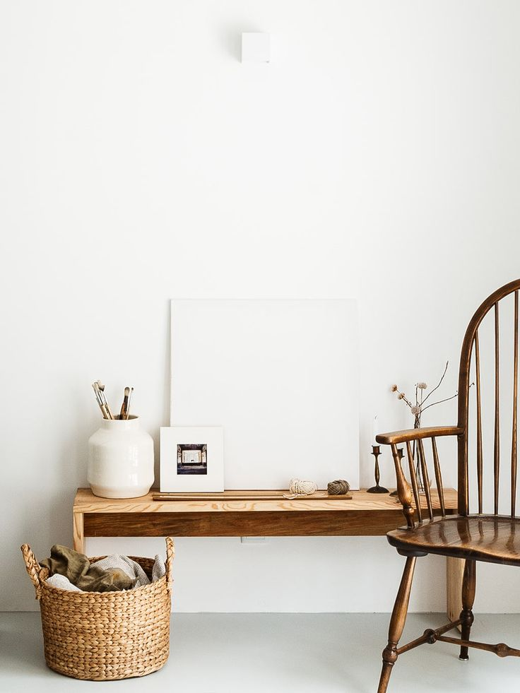 wood and white, shaker style chair, bench, wicker basket, vase