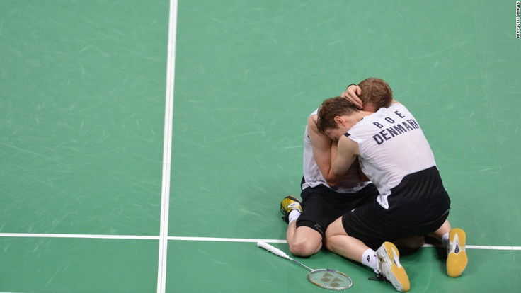 Denmark's Mathias Boe and Carsten Mogensen celebrate their victory over Chung Jae Sung and Lee Yong Dae of South Korea during the semifinal men's doubles badminton match.