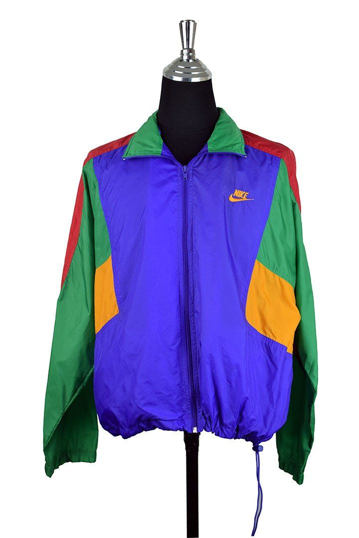 Nike Brand Colourful Spray Jacket :  Vendor: RetroStar Vintage ClothingType: JacketsPrice: 52.00  Nike brand colourful spray jacket  Purpley blue green red and yellow panels  Logo embroidered to front  Elastic waist with toggle  Concealed hood inside collar  Tagged size M (Do not rely on tagged size. Please check measurements for actual size)  Extremely small mark to sleeve  Small marks to front (Please see photos)  Chest: 65cm Length: 65cm