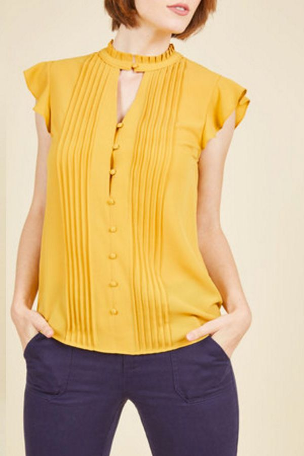 Your knowledge is boundless and your style will be endless in the Zeal Studies Top from the ModCloth namesake label. Show off your stylish intelligence in this mustard blouse with a high, pleated neckline, crisp pintucks, and dainty buttons. Get it today at ModCloth.com.