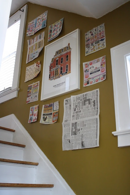 Use newspapers to lay out your art before hanging on walls