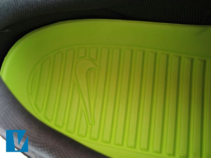 buy online 3e71f a2e3e ... An embossed swoosh logo is featured on the insole of Nike Rosherun  sneakers. Check that Roshe ...