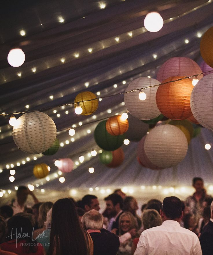 Paper Lanterns and Festoon Lighting - great combination for adding some colour and atmosphere to a wedding marquee