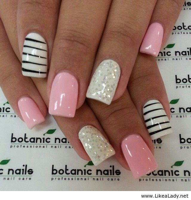Light pink nails with black and white