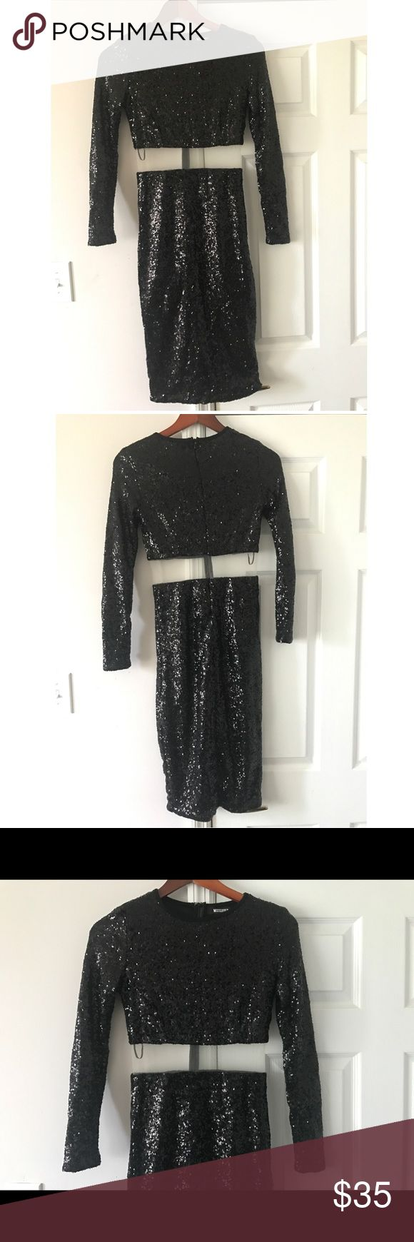 ✨Missguided Black Sequin Dress Sz 8 UK✨ Missguided knee length black sequin dress in a U.K. Size 8. This is a US Size 6, but fits more like a 4, There is some stretch but not too much. This dress is super cute! It is long sleeved and sequined, but with a super cute mesh panel right underneath the bust. There is a zipper down the back. Great dress for holiday parties. Missguided Dresses Midi