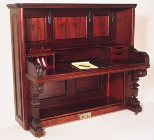 Old Piano that no longer worked is now a gorgeous desk.