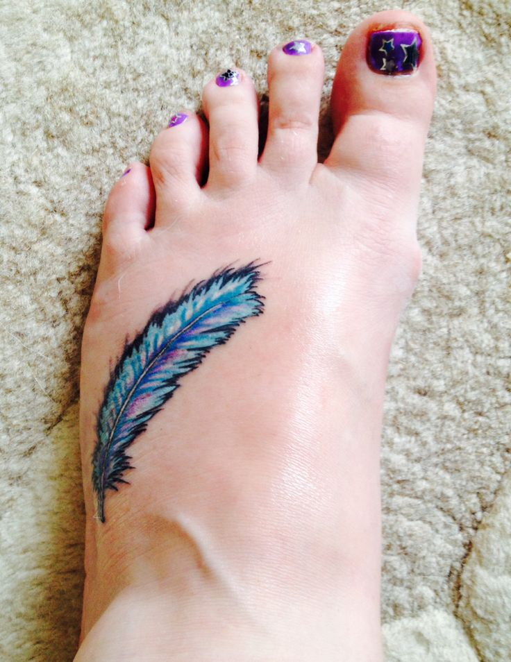 Feather tattoo. Love the colours.