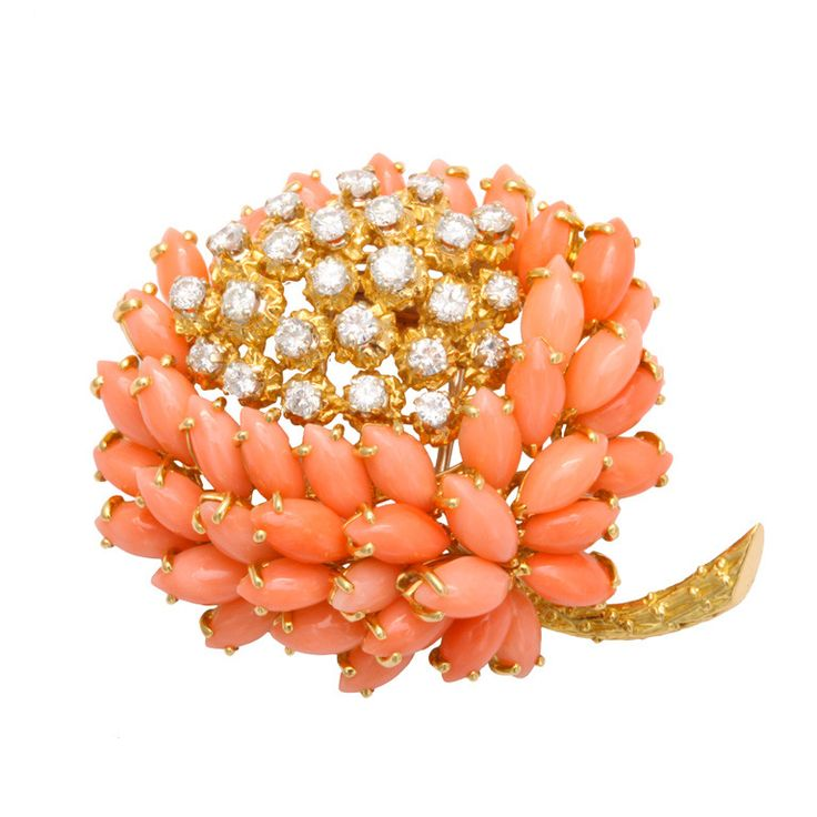 Van Cleef & ArpelsA whimsical Coral and Diamond flower brooch by Van Cleef & Arpels. Consisting of marquise shaped coral and round diamond weighing approximately 1.75 carats, G color VVs2 quality. Set on 18KT yellow gold. Signed with French Hallmarks.Circa 1970s