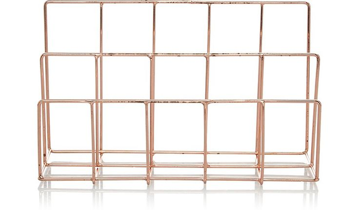 Store away letters, bills and postcards with this stylish letter rack. A simple wire storage solution, this rack is designed with a modern copper-effect fini...