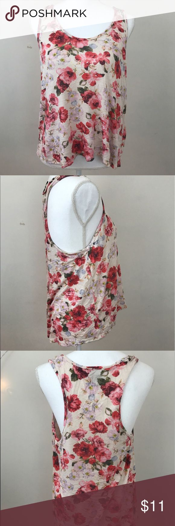 Pink Floral Slouchy Tank from Wet Seal Casual floral tank from Wet Seal!  Light pink material with pink and red floral design.  Super soft material.  Size isn't on the tag, fits like a medium but has lots of stretch.  No stains, no tears, no signs of wear.   Take 20% off any bundle of two or more items 💗 Offers are always considered 🌸 Wet Seal Tops Tank Tops