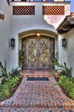 Eclectic Front Door with Arched double door, French doors, exterior brick floors, Pathway, Brick exterior flooring