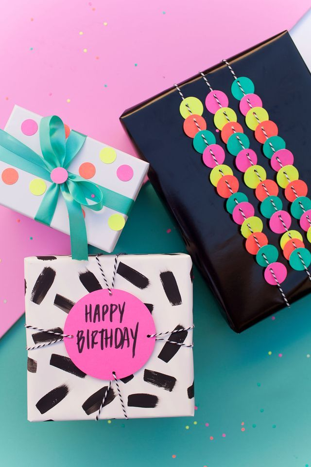 Fun gift wrap idea using a hole punch by tellloveandparty.com