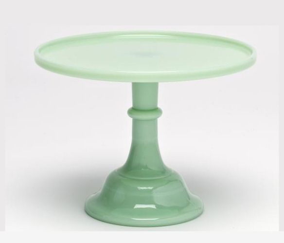 Green round 8 inch ceramic Mosser pedestal cake stand. Over 25 different cake stands available to hire / rent in Dublin, Ireland. Three day rental from €10 - €25.  The Cake Lab Bakery, Ranelagh, Dublin, Ireland. Artisan Baking Studio.