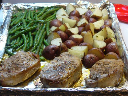An entire meal - pork chops, potatoes and fresh green beans all cooked up on a single pan!