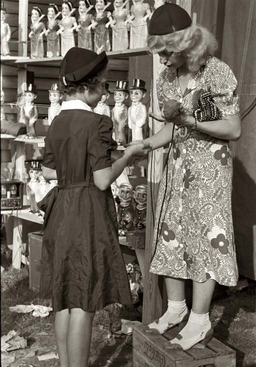"""November 1938. Donaldsonville, Louisiana. """"Young girl buying doll from concession manager at the state fair."""" 35mm nitrate negative by Russell Lee for the Farm Security Administration. Library of Congress."""