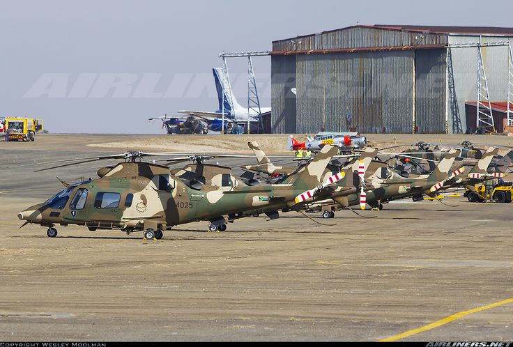 South African Air Force (SAAF)  Agusta A-109E LUH Parked on the apron, shortly after taking part in the Presidential Inauguration flypast for President Jacob Zuma.