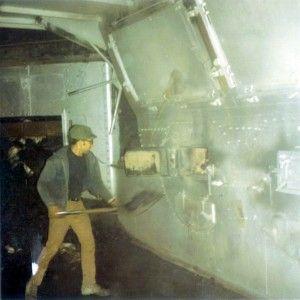 Doug Litzner shoveling coal into the boiler