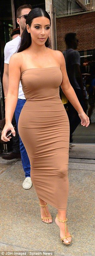 Kylie Jenner is her big sister Kim's mini-me as she steps out in a figure-hugging khaki bandeau dress | Daily Mail Online